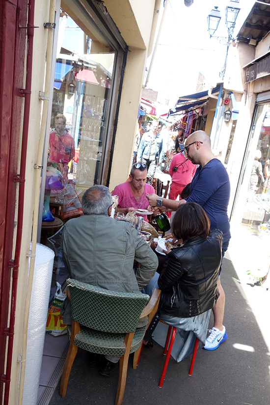 Antique dealers break for lunch in Les Puces